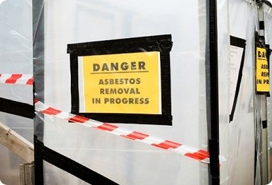 """Danger Abestos Removal in Progress"" sign"
